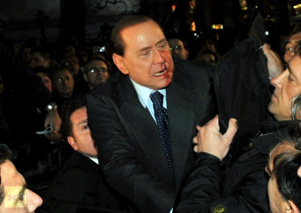 silvio-berlusconi-reacts-assaulted